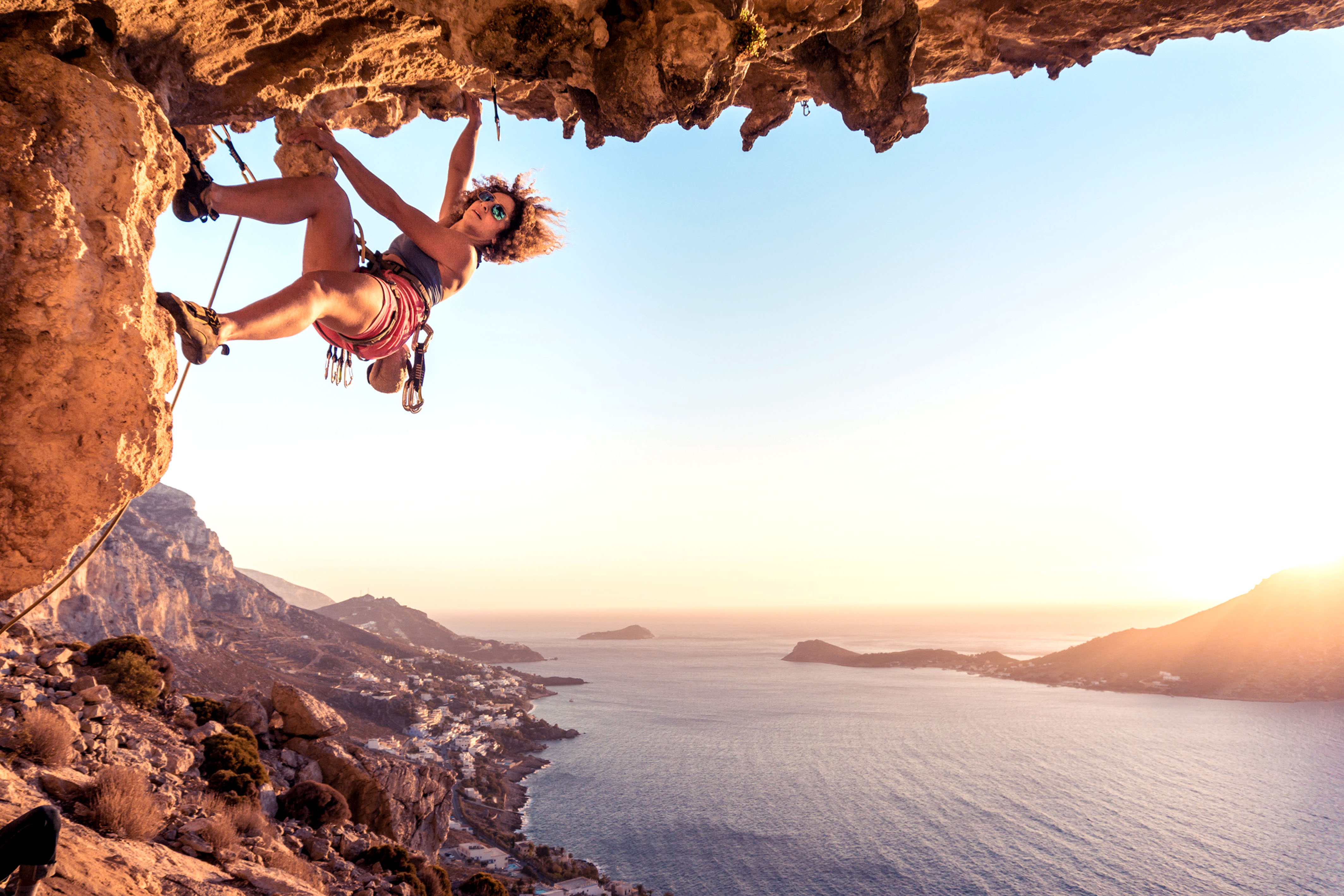 Upside Down Climbers Cling Onto Rock Edge Of Gorgeous
