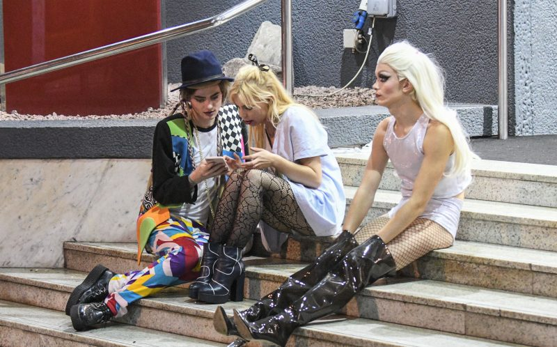 PIC BY MICHAEL SCOTT/CATERS NEWS - (PICTURED: A girl dressed as Boy George sits with another girl and their drag queen friend on the steps of the Jurys Inn on Birminghams Broad Street during the night of Halloween.)It was nightmare on Broad Street last night as thousands of revellers hit the streets for Halloween. Party-goers in Birmingham, West Mids, could be seen collapsed on the floor as paramedics tended to them while another appeared to urinate against a wall. Another guy, dressed in camouflage, was violently sick on the street and a girl was also crouched over vomiting as her friend comforted her. Students went all out with their fancy dress as part of the Nightmare on Broad Street event, which saw over 4,500 people hit the citys infamous strip.