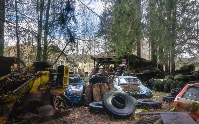 PIC BY ROMAN ROBROEK /CATERS NEWS - (PICTURED: A field where cars and car wrecks are spread all over the place.) - Mother Nature has turned into a scrapyard - as dust, rust and vines clamp and reclaim various abandoned cars. Photographs show a collection of once-grand Rolls Royces, Ferraris, Ford Mustangs and others left to rot all over Europe. Roman, an ICT worker and amateur photographer from the Netherlands, tracked down and photographed the abandoned automobiles. SEE CATERS COPY.