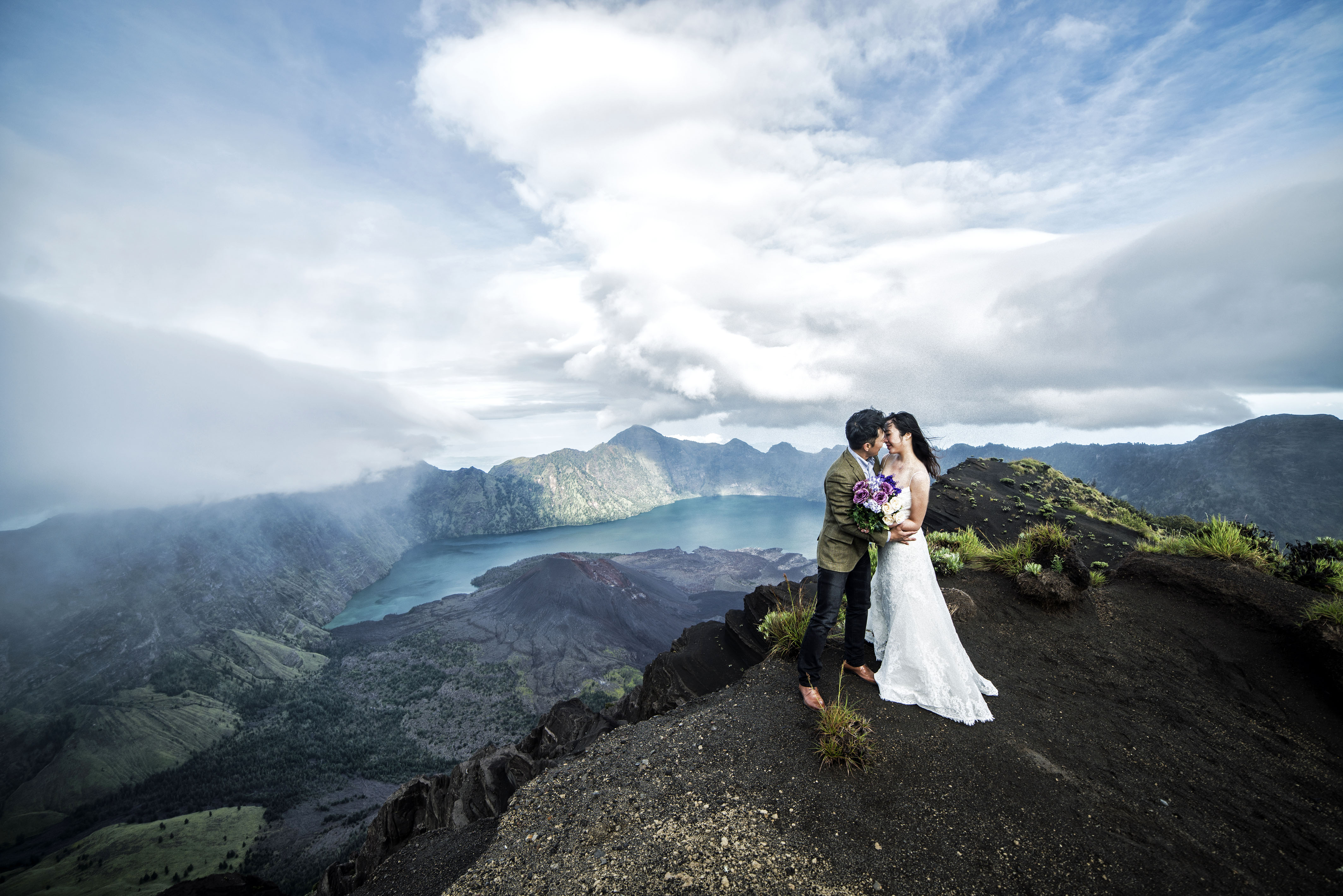 On Cloud Nine Couple Pose For Wedding Photos On The Top