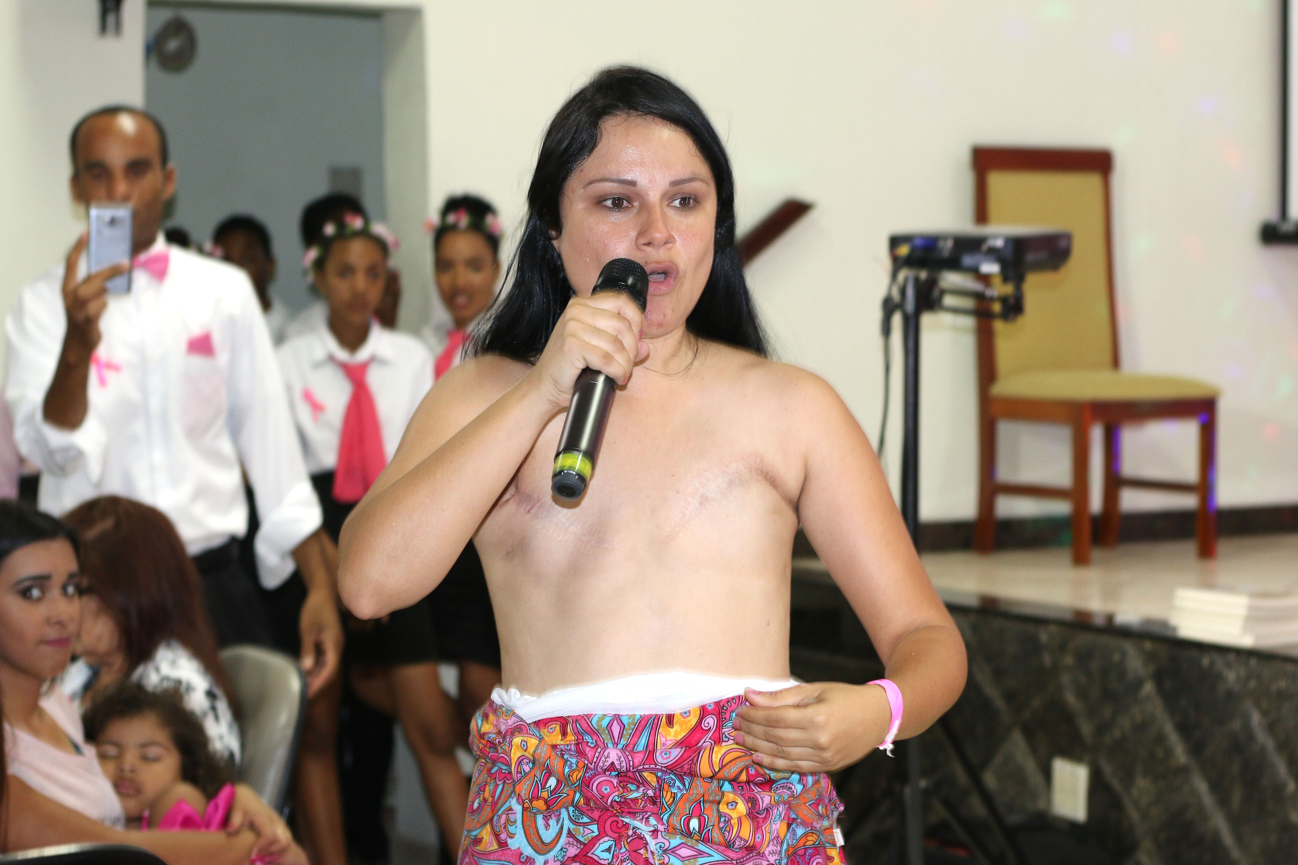 the woman who takes her top off in church caters news agency